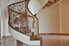 Spiral spiral staircase inside the house. royalty free stock image