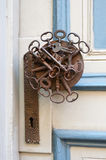 The original door handle in the form of keys Royalty Free Stock Images