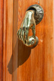 Original door's handle in the shape of a hand Royalty Free Stock Photography