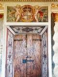 Original Doorway and Fresco, Villa d Este, Tivoli, Italy. Original interior of the historic Villa d`Este, Tivoli, Italy, with a fresco featuring an heraldic Royalty Free Stock Photos