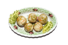 Original eggs. Original dish of the eggs, made of juicy jelly with stuffing from meat. Dish decorated with segments of cucumbers and patterns of flowers royalty free stock photo