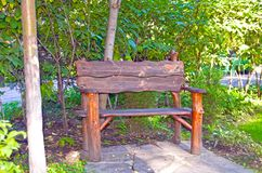Original empty wooden bench in the park. Summer royalty free stock photos