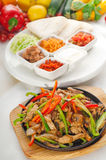 Original fajita sizzling hot  on iron plate Stock Photo