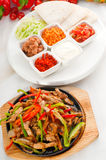 Original fajita sizzling hot  on iron plate Royalty Free Stock Photo