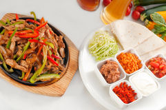 Original fajita sizzling hot  on iron plate Stock Photography