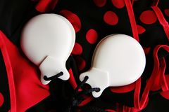 Original flamenco castanets in red background royalty free stock image