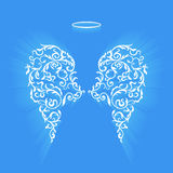 Original floral angel wings and Nimbus. Angel design elements - wings and halo isolated on the blue background. Abstract vector illustration of ornamental stock illustration