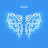 Original floral angel wings and Nimbus. Angel design elements - wings and halo isolated on the blue background. Abstract vector illustration of ornamental vector illustration
