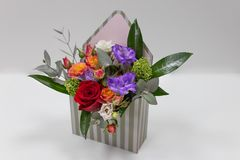 Free Original Floral Arrangement Gift Of Fresh Flowers In A Box In The Form Of An Envelope On A Light Background. Stock Photos - 158878763
