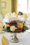 Original floral arrangement on the table. Original flowers arrangement on the table Stock Photo