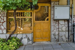 Original front door and fence with vine Royalty Free Stock Image
