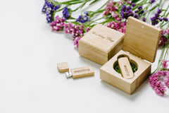 Beautiful white wedding Usb flash drive in Vintage Handmade wooden box with wildflowers . wedding concept stock photos