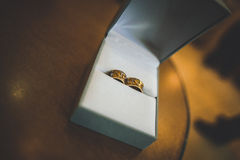 Original golden wedding rings in the white box Stock Photo