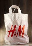 Original H&M plastic shopping bag. POZNAN, POLAND - NOV 3, 2016: H & M Hennes & Mauritz AB is a Swedish multinational clothing-retail company, It operates over 4 Stock Photo