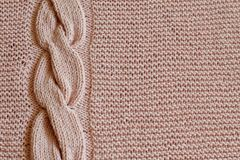 Exclusive delicate pink knitted background with vertical knitted oblique. Handmade. Minimal style stock image