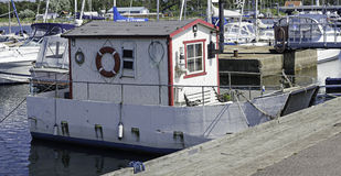 House boat. Boat anchored to duck with ropes Royalty Free Stock Photo