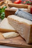Original italian cheese, aged Parmesan cow milk cheese, pieces and grated Parmigiano-Reggiano. Close up stock images