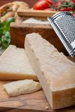 Original italian cheese, aged Parmesan cow milk cheese, pieces and grated Parmigiano-Reggiano. Close up stock image