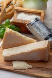 Original italian cheese, aged Parmesan cow milk cheese, pieces and grated Parmigiano-Reggiano. Close up royalty free stock image