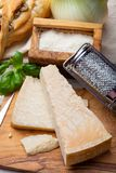 Original italian cheese, aged Parmesan cow milk cheese, pieces and grated Parmigiano-Reggiano. Close up royalty free stock images
