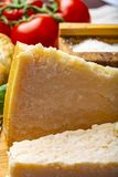 Original italian cheese, aged Parmesan cow milk cheese, pieces and grated Parmigiano-Reggiano. Close up royalty free stock photography