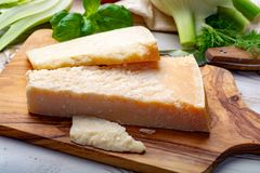 Original italian cheese, aged Parmesan cow milk cheese, pieces of Parmigiano-Reggiano. Close up royalty free stock photography