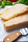 Original italian cheese, aged Parmesan cow milk cheese, pieces of Parmigiano-Reggiano. Close up stock photography