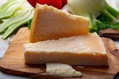 Original italian cheese, aged Parmesan cow milk cheese, pieces of Parmigiano-Reggiano. Close up stock photo