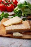Original italian cheese, aged Parmesan cow milk cheese, pieces of Parmigiano-Reggiano. Close up royalty free stock image