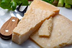 Original italian cheese, aged Parmesan cow milk cheese, pieces of Parmigiano-Reggiano. Close up royalty free stock photos