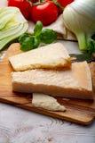 Original italian cheese, aged Parmesan cow milk cheese, pieces of Parmigiano-Reggiano. Close up stock image