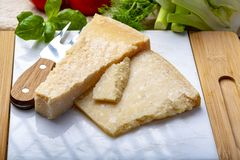 Original italian cheese, aged Parmesan cow milk cheese, pieces of Parmigiano-Reggiano. Close up royalty free stock images