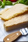Original italian cheese, aged Parmesan cow milk cheese, pieces of Parmigiano-Reggiano. Close up royalty free stock photo