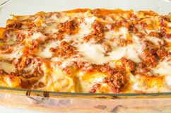 Original italian lasagne on a baking dish Stock Images