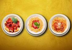 Italian pasta on wall background Stock Photography