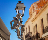 Original lamp on the street in the city of Retimno, the island o. Lamp on the street with original ornament in ancient part of the city of Retimno, the island of royalty free stock image
