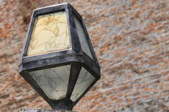 Original lantern in retro style on brick wall background. Mukachevo, Ukraine stock photo