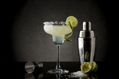 Original Lime Margarita Cocktail. Classic lime margarita cocktail with tequila, triple sec, lime juice, crushed ice and some salt on the rim of a glass royalty free stock photography