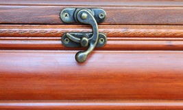 Original lock on a wooden casket Stock Photo