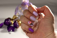 Original manicure covered with gel varnish with an ice cream pat stock images