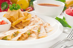 Original Mexican quesadilla de pollo. With nachos  served with gazpacho soup and watermelon ,with fresh vegetables on background Royalty Free Stock Images