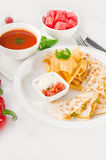 Original Mexican quesadilla de pollo. With nachos  served with gazpacho soup and watermelon ,with fresh vegetables on background Stock Photo