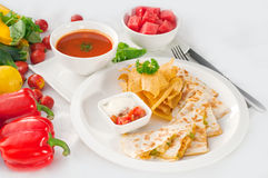 Original Mexican quesadilla de pollo. With nachos  served with gazpacho soup and watermelon ,with fresh vegetables on background,MORE DELICIOUS FOOD ON Royalty Free Stock Photography