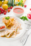 Original Mexican quesadilla de pollo. With nachos  served with gazpacho soup and watermelon ,with fresh vegetables on background Stock Photos
