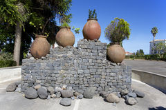 The original monument in the city of Santana, Madeira. Stone pedestal and four ceramic pot with flowers royalty free stock photography