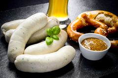 Original Munich sausage with Hefeweizen and pretzel Royalty Free Stock Photography