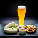 Original Munich sausage with Hefeweizen and pretzel Stock Images