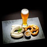 Original Munich sausage with Hefeweizen and pretzel Stock Photos