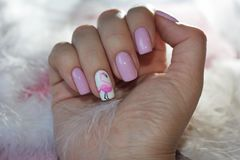 Original nails with a pattern of flamingos cozy Royalty Free Stock Photography
