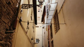 An original narrow street with old houses in the historic part of Florence. Steadicam shot stock video footage